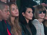 Jay-Z, from left, Beyonce, Kim Kardashian, Anna Wintour and Russell Simmons, fourth from right, attend fashion show from Kanye West Adidas Fall 2015 collection, during Fashion Week on Thursday, Feb. 12, 2015, in New York. (AP Photo/Bebeto Matthews)