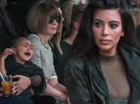 Kim Kardashian attempts to calm her daughter, North, while sitting next to Sean Combs (L), Jay-Z (2nd L), Beyonce (3rd L) and Anna Wintour (2nd R) as they watch a presentation of Kanye West's Fall/Winter 2015 partnership with Adidas at New York Fashion Week February 12, 2015. REUTERS/Lucas Jackson (UNITED STATES - Tags: FASHION SOCIETY ENTERTAINMENT)