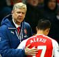 LONDON, ENGLAND - FEBRUARY 10:  Arsene Wenger, manager of Arsenal speaks with Alexis Sanchez of Arsenal as he is substituted during the Barclays Premier League match between Arsenal and Leicester City at Emirates Stadium on February 10, 2015 in London, England.  (Photo by Richard Heathcote/Getty Images)