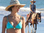 *EXCLUSIVE* Trancoso, Brazil - Alessandra Ambrosio enjoys some much deserved vacation time in Brazil and hits the beach with family and friends. The Victoria's Secret Angel can be seen playing in the water and horseback riding wearing a tiny light green two piece bikini and a floppy hat\nAKM-GSI           February 15, 2015\nTo License These Photos, Please Contact :\n \n Steve Ginsburg\n (310) 505-8447\n (323) 423-9397\n steve@akmgsi.com\n sales@akmgsi.com\n \n or\n \n Maria Buda\n (917) 242-1505\n mbuda@akmgsi.com\n ginsburgspalyinc@gmail.com