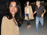 UK CLIENTS MUST CREDIT: AKM-GSI ONLY EXCLUSIVE: **MUST CALL FOR PRICING** Actor, George Clooney, and his wife, Amal Clooney, enjoyed a late Valentines Day at George Clooney's favorite sushi joint in Los Angeles. The happy couple held hands as they walked over to the valet where chivalrous George let Amal get into the car first and then got in himself.  Amal was radiant in a tan suede fringed cape, black pants, nude python boots, and blue oversized portfolio clutch while George kept it casual in a grey short-sleeve button-down shirt, jeans, and brown shoes.  Pictured: George Clooney, Amal Clooney Ref: SPL953006  150215   EXCLUSIVE Picture by: AKM-GSI / Splash News