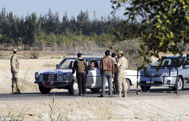 Egyptian security personnel check cars at a checkpoint near the site, where separate attacks on security forces in North Sinai on Thursday killed 30 people, in Arish, North Sinai, Egypt on January 31