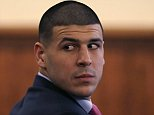 Former NFL player Aaron Hernandez looks back at the gallery during his murder trial at the Bristol County Superior Court in Fall River, Mass., Thursday, Feb. 19, 2015. Hernandez is accused in the June 17, 2013, killing of Odin Lloyd, who was dating his fiancee's sister. (AP Photo/Charles Krupa, Pool)