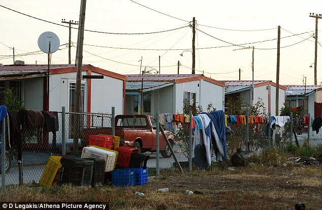 Camp site: Clothes are hang out on the fence to dry at the camp which was raided by police looking for drugs and weapons