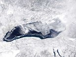 This satellite image of Lake Ontario from Tuesday shows ice covering much of the lake. The white areas on the lake are snow-covered ice; other areas of the lake could be covered with thin ice that doesn't show up in this photo.