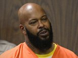 epa04602312 US rapper/music producer Marion 'Suge' Knight (R), next to his attorney David E Kenner, is arraigned on murder charges in Superior Court in Compton, California, USA, 03 February 2015. Knight is accused of murder in the hit-and-run death of Terry Carter. Knight was held without bail.  EPA/PAUL BUCK / POOL