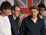 Alex James, Dave Rowntree, Damon Albarn and Graham Coxon of British alternative rock band Blur pose on the red carpet arriving at the BRIT Awards 2012 in London.   AFP PHOTO / BEN STANSALL (Photo credit should read BEN STANSALL/AFP/Getty Images)
