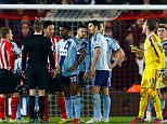SOUTHAMPTON, ENGLAND - FEBRUARY 11:  Adrian of West Ham receives a red card from referee Craig Pawson after diving on the ball outside of the area ahead of Sadio Mane of Southampton during the Barclays Premier League match between Southampton and West Ham United at St Mary's Stadium on February 11, 2015 in Southampton, England.  (Photo by Julian Finney/Getty Images)