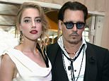 LOS ANGELES, CA - JANUARY 10:  Actors Amber Heard (L) and Johnny Depp attend the Art of Elysium and Samsung Galaxy present Marina Abramovic's HEAVEN at Hangar 8 on January 10, 2015 in Los Angeles, California.  (Photo by Jason Kempin/Getty Images  for Art of Elysium)