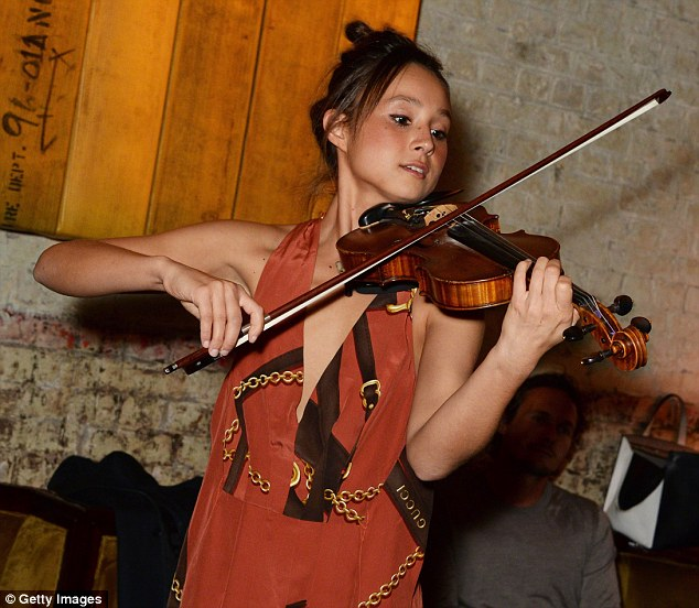 Holzwarth plays violin at tech parties and also works for the startup Shyp