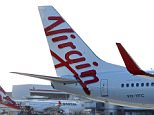 Virgin Australia's new  Boeing 737 airplane touches down on the tarmac just prior to a  ebranding launch, which saw Virgin Australia replace Virgin Blue and V Australia, at Sydney Airport in Sydney, Australia.    (Photo by Don Arnold/Getty Images)
