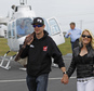 FILE - In this May 17, 2014 file photo, Kurt Busch, left, walks with his girlfriend, Patricia Driscoll, after arriving for the NASCAR Sprint All-Star auto race at Charlotte Motor Speedway in Concord, N.C. Attorneys for the NASCAR driver asked a Delaware judge on Thursday, Feb. 19, 2015, to reopen a Family Court hearing that resulted in Busch's ex-girlfriend Driscoll being granted a no-contact order. (AP Photo/Terry Renna, File)
