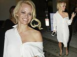 Pam Anderson dresses in all white as shel leaves Spaghettini restaurant in LA wearing an all white ensemble which revealed what appears to be bruising on her back left shoulder.   Pictured: Pamela Anderson Ref: SPL949059  190215   Picture by: Bello / Splash News  Splash News and Pictures Los Angeles: 310-821-2666 New York: 212-619-2666 London: 870-934-2666 photodesk@splashnews.com
