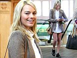 """UK CLIENTS MUST CREDIT: AKM-GSI ONLY EXCLUSIVE: Australian beauty Margot Robbie shows her big bright smile and toned legs in a pair of short shorts as she prepares to catch a flight out of town in Albuquerque, New Mexico on February 20, 2015. Margot looked cute in a brown tweed blazer and long white blouse covering her shorts and oxford shoes. The """"Focus"""" star was busy on her phone and appeared to be taking salad in a to-go tupperware for her flight.  Pictured: Margot Robbie Ref: SPL956867  200215   EXCLUSIVE Picture by: AKM-GSI / Splash News"""