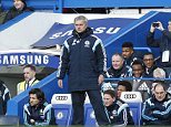 Chelsea's manager Jose Mourinho watches his team playing against Burnley during an English Premier League soccer match at the Stamford Bridge ground in London, Saturday, Feb. 21, 2015. The match ended in a 1-1 draw. (AP Photo/Lefteris Pitarakis)