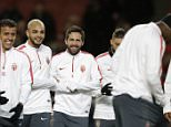 AS Monaco's Joao Moutinho, center, laughs with his teammates during a Champions League soccer training session at the Emirates Stadium in London, Tuesday, Feb. 24, 2015. Arsenal face AS Monaco in a round of 16 Champions League soccer match in London on Wednesday. (AP Photo/Matt Dunham)