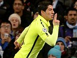 Barcelona's Luis Suarez celebrates scoring his side's first goal of the game during the UEFA Champions League, Round of 16 match at the Etihad Stadium, Manchester. PRESS ASSOCIATION Photo. Picture date: Tuesday February 24, 2015. See PA story SOCCER Man City. Photo credit should read: Martin Rickett/PA Wire