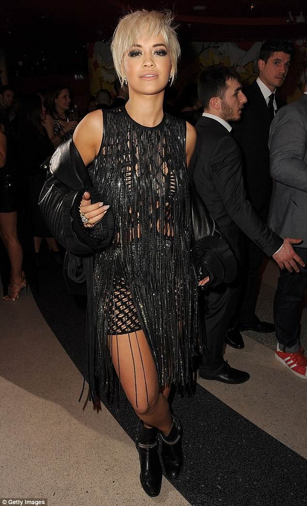 Accessory queen: She teamed the Julien MacDonald AW15 piece with a pair of black studded ankle boots and a leather biker jacket