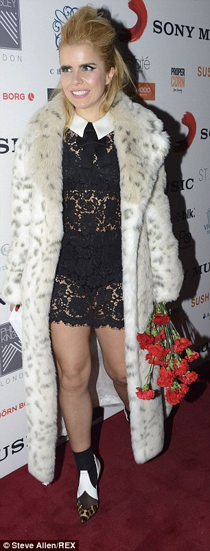 Peek-a-boo: Paloma flashed her underwear underneath her lace frock