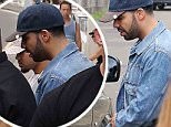February 26, 2015: Drake seen leaving Bondi's Icebergs. His security emerge first and swore at his fans, demanding they step back and don't ask Drake for photos or signatures. Sydney, Australia. EXCLUSIVE. Mandatory Credit: INFphoto.com Ref: infausy-08
