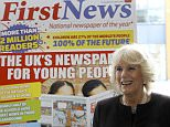 Britain's Camilla, The Duchess of Cornwall, unveils a plaque at the children's newspaper 'First News' offices in London, Wednesday, Feb. 25, 2015. The Duchess visited to officially open the offices and tour the building, meeting staff and young people taking part in the paper's 'Children United' project. (AP Photo/Kirsty Wigglesworth, pool)