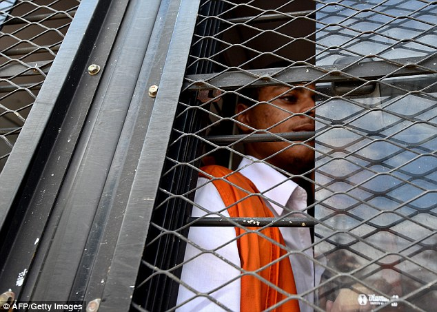 Behind bars: Schaefer, pictured today, and Mack face a maximum penalty of death by firing squad if found guilty