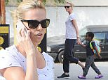 ©BAUER-GRIFFIN.COM\nCharlize Theron and Jackson Theron are seen in Los Angeles\nNON EXCLUSIVE Feb 26, 2015\nJob: 150226Z2 Los Angeles, CA\nwww.bauergriffin.com\n