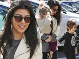 """Woodland Hills, CA - """"KUWTK"""" reality tv star Courtney Kardashian takes her children, Penelope and Mason, to a children's birthday party at Sky High Sports in Woodland Hills.  The pretty mama wore a casual get up consisting of a white leather jacket, grey shirt, black capri leggings, and sneakers as she carried her youngest to the indoor playground. \n  \nAKM-GSI        February 28, 2015\nTo License These Photos, Please Contact :\nSteve Ginsburg\n(310) 505-8447\n(323) 423-9397\nsteve@akmgsi.com\nsales@akmgsi.com\nor\nMaria Buda\n(917) 242-1505\nmbuda@akmgsi.com\nginsburgspalyinc@gmail.com"""