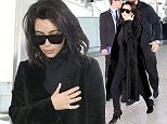 27.FEB.2015 - LONDON - UK KIM KARDASHIAN ARRIVING AT LONDON HEATHROW AIRPORT LOOKING A LITTLE BIT WORSE FOR WEAR AFTER HAVING VERY LITTLE SLEEP. KIM WAS OUT UNTIL THE EARLY HOURS OF THE MORNING PARTYING WITH HER HUSBAND KANYE WEST. BYLINE MUST READ : XPOSUREPHOTOS.COM ***UK CLIENTS - PICTURES CONTAINING CHILDREN PLEASE PIXELATE FACE PRIOR TO PUBLICATION *** UK CLIENTS MUST CALL PRIOR TO TV OR ONLINE USAGE PLEASE TELEPHONE 0208 344 2007**