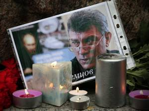 Russians lay flowers and light candles in memory of Boris Nemtsov at the monument of political prisoners 'Solovetsky Stone' in St. Petersburg, Russia