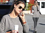UK CLIENTS MUST CREDIT: AKM-GSI ONLY EXCLUSIVE: Alessandra Ambrosio grabs coffee to-go and a pastry at the Country Mart in Brentwood, CA while chatting on her cell phone on March 2, 2015.  Pictured: Alessandra Ambrosio Ref: SPL966595  020315   EXCLUSIVE Picture by: AKM-GSI / Splash News