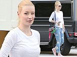 Please contact X17 before any use of these exclusive photos - x17@x17agency.com   Iggy Azalea takes a break from the studio chatting with friends outside weaing minimal make up and Star jeans. Iggy recenly teamed up with Jennifer Hudson for the hit single Trouble. She also quit social media after body shaming attacks.  March 3, 2015 X17online.com
