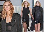 PARIS, FRANCE - MARCH 03:  Karlie Kloss attends the Anthony Vaccarello show as part of the Paris Fashion Week Womenswear Fall/Winter 2015/2016  on March 3, 2015 in Paris, France.  (Photo by Pierre Suu/Getty Images)