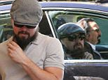 "Picture Shows: Leonardo DiCaprio  March 06, 2015\n \n Shy actor Leonardo DiCaprio does his best to avoid the cameras while visiting a bank in Beverly Hills, California. \n \n Even though Leo has been linked romantically to singer Rihanna, a rep for DiCaprio recently revealed that he ""is single and has been for some time.""\n \n EXCLUSIVE ALL ROUNDER\n UK RIGHTS ONLY\n \n Pictures by : FameFlynet UK © 2015\n Tel : +44 (0)20 3551 5049\n Email : info@fameflynet.uk.com"
