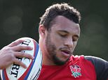 BAGSHOT, ENGLAND - MARCH 10:  Courtney Lawes catches the ball during the England training session held at Pennyhill Park on March 10, 2015 in Bagshot, England.  (Photo by David Rogers/Getty Images)