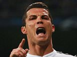MADRID, SPAIN - MARCH 10:  Cristiano Ronaldo of Real Madrid CF celebrates as he scores their second goal during the UEFA Champions League Round of 16 second leg match between Real Madrid CF and FC Schalke 04  at Estadio Bernabeu on March 10, 2015 in Madrid, Spain.  (Photo by Alex Grimm/Bongarts/Getty Images)