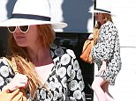 Picture Shows: Isla Fisher  March 13, 2015\n \n Pregnant actress Isla Fisher looks ready to pop after enjoying lunch at Joan's On Third in Studio City, California. Isla is pregnant with her third child with husband Sacha Baron Cohen.\n \n Non-Exclusive\n UK RIGHTS ONLY\n \n Pictures by : FameFlynet UK © 2015\n Tel : +44 (0)20 3551 5049\n Email : info@fameflynet.uk.com