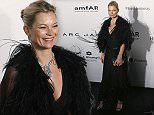 English model Kate Moss poses on the red carpet for the fundraising gala organized by amfAR (The Foundation for AIDS Research) in Hong Kong Saturday, March 14, 2015. (AP Photo/Kin Cheung)