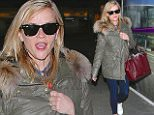 Reese Witherspoon arrives in LA in olive Caption: Reese Witherspoon was wearing a hooded coat with jeans, arriving on a late flight into LA, on Friday, March 13, 2015  X17online.com