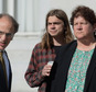 Scott Olsen, center, and his attorneys, James Chanin, left, and Rachel Lederman, right, await the start of a news conference at Frank Ogawa Plaza in Oakland,...