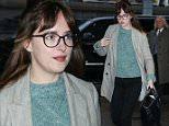 Dakota Johnson is seen at JFK airport escorted by police on March 14, 2015 in New York City. (Photo/Video by PapJuice.com) \n\nPictured: Dakota Johnson\nRef: SPL975320  140315  \nPicture by: PapJuice.com / Splash News\n\nSplash News and Pictures\nLos Angeles: 310-821-2666\nNew York: 212-619-2666\nLondon: 870-934-2666\nphotodesk@splashnews.com\n