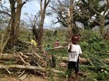 Children inspect the debris while residents deal with the damage to their homes in Seaside, near the Vanuatu capital of Port Vila ©Chris McCowage (Australian Red Cross/AFP)