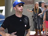 Please contact X17 before any use of these exclusive photos - x17@x17agency.com   Chris Martin takes Apple to hang out with friends at Santa Monica Pier in Malibu. he flashes the peace sign to a driver who stops and lets them cross the street.  March 15, 2015 X17online.com