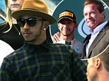 F1 champ Lewis Hamilton takes a Qantas BUGGY as he arrives at Sydney's Qantas domestic terminal on Monday lunchtime. (March 16)\nHat-wearing Lewis, who was also wearing what appeared to be studded shoes, arrived from Melbourne at 2.30pm and stood waiting while his security organised the electric-powered vehicle.\nHe also posed for pics with fans after getting onboard his unusual mode of transport.\nLewis was then driven 250metres to the main pedestrian exit gate, where he got off the buggy to head down an escalator to his waiting limo.\nLewis is in Sydney to fulfil media commitments.\n\nPictured: F1 champ Lewis Hamilton takes a Qantas BUGGY as he arrives at Sydneyís Qantas domestic terminal on Monday lunchtime. (March 16)\nRef: SPL976311  150315  \nPicture by: Grant Hodgson / Splash News\n\nSplash News and Pictures\nLos Angeles: 310-821-2666\nNew York: 212-619-2666\nLondon: 870-934-2666\nphotodesk@splashnews.com\n