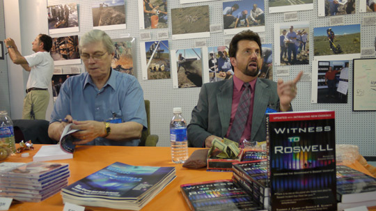 Don Schmitt and Tom Carey signing books and talking to visitors in the Roswell UFO Museum. (image credit: Alejandro Rojas)