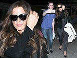 Kate Beckinsale  arrives at LAX wearing sungalsses and acting shy March 15, 2015 X17online.com