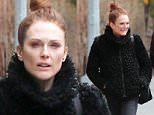 ***MANDATORY BYLINE TO READ INFPhoto.com ONLY***\nJulianne Moore and husband Bart Freundlich walking through the West Village district of New York City this morning after having branch at Cafe Cluny.\ninfusny-279\n\nPictured: Julianne Moore, Bart Freundlich\nRef: SPL977383  160315  \nPicture by: INFphoto.com\n\n