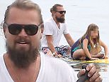Please contact X17 before any use of these exclusive photos - x17@x17agency.com   Leonardo DiCaprio Sunday funday paddle boarding in Malibu with a friends daughter. Drake reportedly doesn't think Rihanna and Leonardo DiCaprio will last because she likes her men more ''ripped''  Maybe Leo is being body conscious wearing a tee shirt while at the beach March 15, 2015 X17online.com