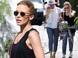 EXCLUSIVE: Kylie Minogue and Dannii Minogue spend a day out together in Melbourne.\nThe Minogue sister were seen walking together as they visited a Chinese Medicine Clinic, with Kylie carrying a carry bag from the clinic after leaving.\nKylie was dressed down for the occasion, wearing ripped blue jeans and a black singlet top, while Dannii dressed up for the occasion wearing heeled shoes with business pants, a white tip, white scarf, silver bag and a large hat. \n\nPictured: Kylie Minogue and Dannii Minogue\nRef: SPL971033  100315   EXCLUSIVE\nPicture by: Splash News\n\nSplash News and Pictures\nLos Angeles: 310-821-2666\nNew York: 212-619-2666\nLondon: 870-934-2666\nphotodesk@splashnews.com\n