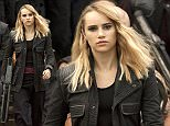 """In this image released by Lionsgate, Rosa Salazar, foreground from left, Emjay Anthony and Suki Waterhouse appear in a scene from """"The Divergent Series: Insurgent."""" (AP Photo/Lionsgate, Andrew Cooper)"""